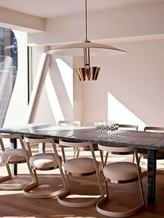 Rustic dining table with modern seating | living.