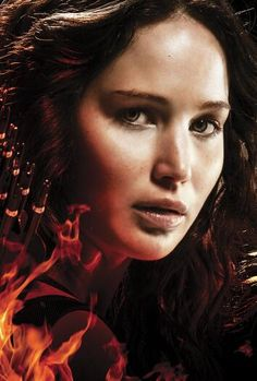 my 2nd fave pic maybe because its close up and she not holding an bow and arrow which is always included in any catching fire promo and pics...