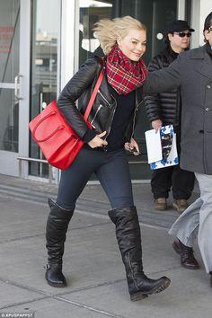 Margot Robbie wearing Elena Ghisellini Vicky Bag, Frye Valerie Otk Shearling Boots, Saint Laurent Belted Moto Leather Jacket and DL1961 Florence Jeans in Barcelona