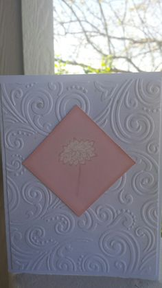 A couple of clean and simple cards. One for sympathy and the other is thinking of you.  White cardstock,  embossing folder sprayed with dylusions (lt. Blue and lt. Pink), image from dollar bin at Michaels, blocked off words, clear embossed on pink cardstock,  then bleached the inside of the flower.  Sponged ink around image.  Glitter glue in a few spots on card for extra bling. Hard to see in pictures but nice touch in person.