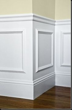 Easy wainscotting idea: buy frames from Michaels, glue to wall and paint over entire lower half. Got this tip from a savvy home improvement person.