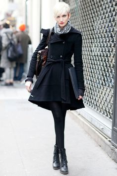 LOVE this outfit of a black swing skirt double breasted coat over a short dress, tights, combat booties, and patterned scarf and brown leather shoulder bag. Looks amazing with her platinum blonde pixie cut had and red lips. Tres Chic