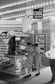 It's Cool Inside. People buying movie tickets. The Jack Benny movie poster in the background (Buck Benny Rides Again) dates this to 1940 or a few years after.