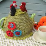 3 hens tea cosy from jollynicegifts.com. £40 Hand knitted and finished with 3 hens, flowers and pretty buttons. Yes, we do like chickens - you'll see them a lot! #weddinggift #mothersday #teacosy
