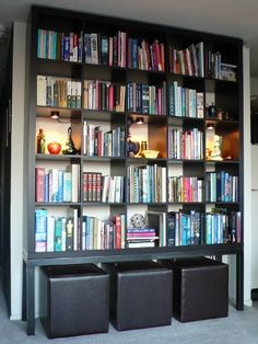 In this IKEA hack from Kramer Design Studio, via Apartment Therapy, a steel frame gives a Expedit a little extra height, and provides a spot to store a little extra seating. 15 Super Smart Ways to Use the IKEA Kallax Bookcase Ikea Hack, Kallax Ikea, Bookcase, Ikea, Ikea Bookcase, Chicago Furniture, Built In Bookcase, Ikea Furniture, Home Library