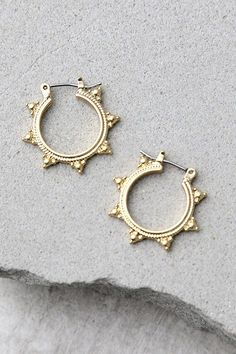 "Add a burst of fun to any look with the Sundrop Gold Earrings! Small engraved gold hoop earrings. Earrings measure 0.75""."