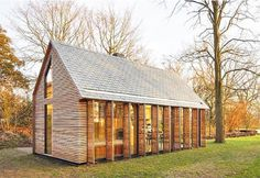 This beautiful Dutch summer house was built into the footprint of the existing structure using western red cedar, oak, and slate stone.