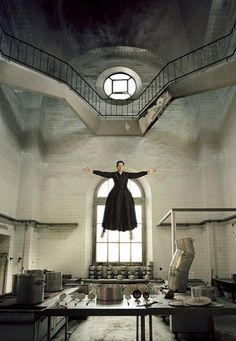 """Marina Abramović in """"The Kitchen (Homage to Saint Therese)"""" performance in La Fabrica (Madrid, Spain) 2009. It has a little to do with hedonism, but it certainly looks vicious. Lake a bad sister of Mary Poppins:)))"""