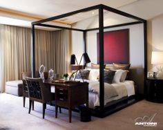 Custom Pierre Cronje four poster bed | House In Cape Town by Antoni Associates designers