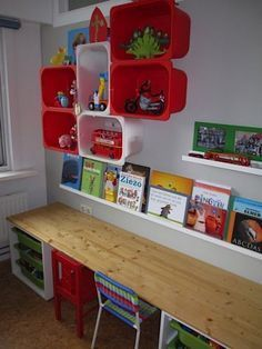 Colorful Shelving made from IKEA plastic boxes. I also like how the table / workspace is done. Desk along the wall. Want a desk for kids' playroom. Trofast Ikea, Childrens Desk, Home Daycare, Kids Room Organization, Toy Rooms, Kids Rooms, Toy Storage, Storage Ideas, Wall Storage