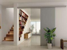La bibliothèque et l'escalier qui se répondent... bel effet trompe l'oeil