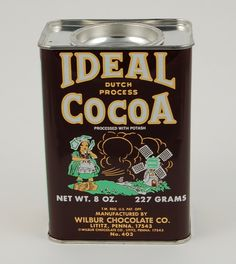 Ideal Cocoa tin from the 60s has charming images of a windmill and a dutch girl wearing wooden shoes.