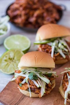 This apple butter bbq chicken sandwich is made with a spicy homemade apple butter bbq sauce, roasted chicken breast and topped with a tangy apple cilantro slaw.