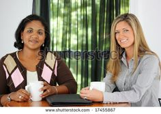 Two Friends Sitting At A Table Together - stock photo