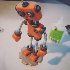 In progress: an Orange Olie without his dolly but still sad  | Handmade by HerArtSheLoves of Robots Are Awesome http://theawesomerobots.com