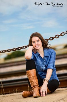 Kaylee took a break in front of the train tracks on the outskirts of The West End in Downtown Dallas.