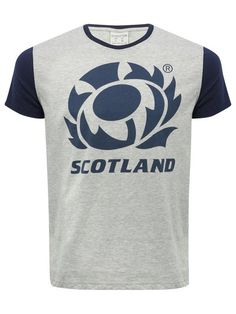 Official Scotland Rugby T-Shirt. Support Scotland in the Rugby World Cup wearing this short sleeved, grey t-shirt with contrasting navy sleeves woven in soft cotton. Offering a relaxed fit with a large official Scottish Rugby Union emblem printed on the front, this is sure to be your lucky charm during games!