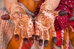 An Indian woman showing hands decorated with intricate henna tattoos   Gavin Gough