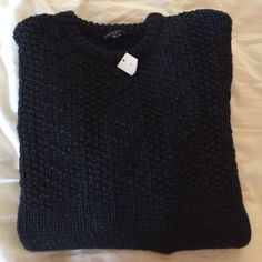 Theory cable knit sweater Perfect winter knit sweater! Soft. Black with a hint of grey in the weaving. Open to offers. No trades. 52% wool. 46% nylon. 2% spandex. Unisex style. The theory tag unattached on one side, which happens often. No big deal and easy fix. Theory Sweaters