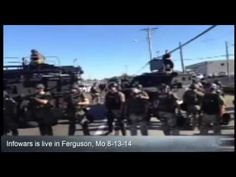80 riot police pointed loaded weapons at demonstrators In Ferguson, Mo