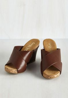 Art Festival Frolic Wedge in Mahogany. Flitting between pottery stalls and poetry readings in these mahogany wedges, you discover that the most artistic view is the way you strut! #brown #modcloth