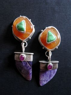 jewelry image of Sterling Silver, Chinese Turquoise on Citrus Chalcedony, Ruby on Charoite. $500.