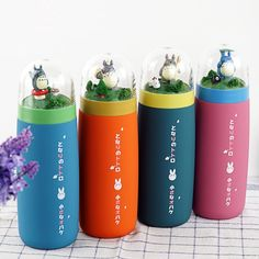 These Totoro thermos bottles are a delight for the young and young at heart. Each comes with a clear plastic dome lid showcasing a playful Totoro and friend's forest scene. <br>  <ul><li> Stainless steel vacuum thermos for hot and cold beverages.