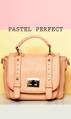 Mini messenger crossbody bag in blush with a top handle and metal hardware