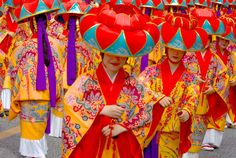 Love the bright bold colors of these Okinawan dancers.