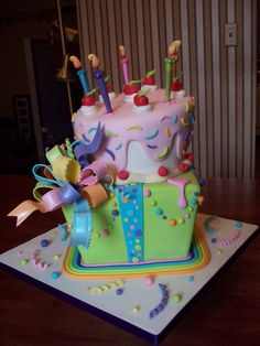 fantasy cake idea. how CUTE is that?  LOVE the rainbow bottom border!