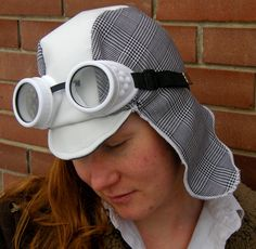 This hat is made with a white pleather and polyester plaid, lined with gray polyester velveteen. It has a small reinforced brim on the front of the hat giving it the appearance of an early century driving cap. Driving Cap, Aviator Hat, Summer Bucket Lists, To My Daughter, Steampunk, Plaid, Gray, Hats, Design