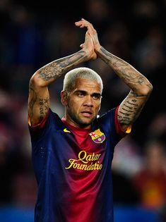 Daniel Alves Photos - Dani Alves of FC Barcelona applauds the fans during  the La Liga d4ee8f7edeb59