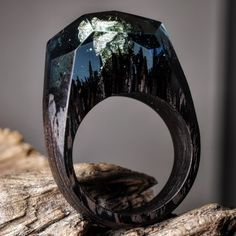 Wenge, a dark colored wood, is the product of Millettia laurentii.Wenge (/ˈwɛŋɡeɪ/ weng-gay) is a tropical timber, very dark in color with a distinctive figure and a strong partridge wood pattern. The wood is heavy and hard.All our rings are handmade and unique. We use fresh wood, jewelry resin and beeswax. The rings are designed and made by Secret Wood exclusively.What you see is the actual ring sent to the customer, we never edit any pictures. When you order this ring, it w...