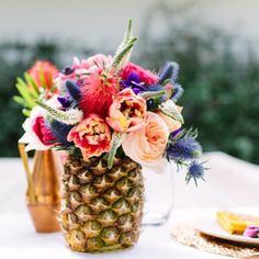 This DIY pineapple vase is the perfect centerpiece for a summer party. Save the inside for a tasty punch.  Photo by @marycostaphoto
