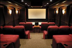 Oh, to have a whole room dedicated solely to watching movies...and to do it in such style and comfort...
