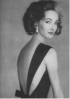 Vogue May 1956 - Dovima sort of has a younger Cruella de Vil thing going on.  Still gorgeous.