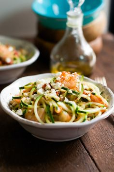 This is a quick and easy Garlic Shrimp with Zucchini Noodles recipe loaded with nutrients that makes a healthy and delicious gluten free and paleo weeknight meal. - primaverakitchen.com