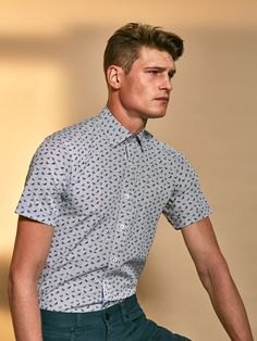 Shaped Fit Short Sleeve Blue Birds on Pin Stripes composite overlay print cotton shirt with point collar. Fashioned in premium quality fabric with genuine mother of pearl buttons, contrast detail and a curved hem. This impeccably tailored shirt is a warm Men's Shirts And Tops, Casual Shirts, Fashion Suits, Mens Fashion, Mother Of Pearl Buttons, Workout Shorts, Blue Bird, Warm Weather, Printed Cotton