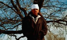 David Foster Wallace in front of a tree.