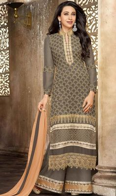 Break the monotony as Bollywooddiva Karisma Kapoor with this gray georgette palazzo suit. The ethnic lace and resham work to your attire adds a sign of beauty statement for your look. #AdorableGrayEmbroideredPalazzoDress