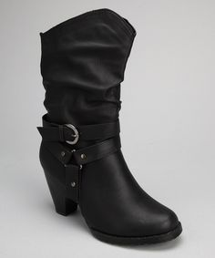 Touched with a hint of country chic, these dapper boots boast a sturdy heel and handy zipper along the side. Stirrup and buckle details dress up the slightly slouchy silhouette.3'' heel8'' shaft12'' circumferenceSide zipper closureMan-made