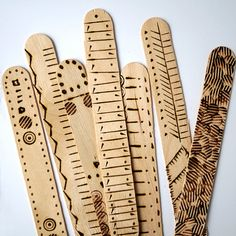 Math sticks converted to bookmarks decorated with pyrography!
