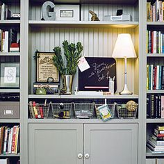 Freestanding wall units can be much less expensive than built-ins. Create a niche in the unit for a workstation to add even more function.