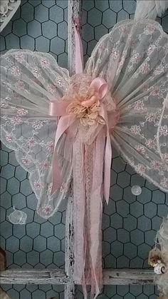 Petal Pink Angel Wings These beautiful little angel wings are made from an abandoned wire hanger that has been wrapped with tattered and torn strips of vintage white fabric. An abandoned piece of gorgeous vintage sheer pink fabric from a dress with sweet little embroidered