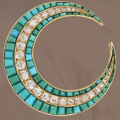 A Victorian 18K yellow gold crescent moon pin set with 72 square panels of turquoise and thirty old mine cut diamonds