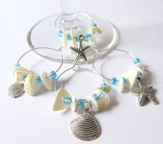 Wine glass charms - love the color choice of aqua with the white