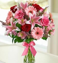Example of lilies and gerberas together with roses, alstromeria, and filler flowers.