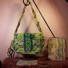 """Vera Bradley bundle.  Bag, wristlet, tablet cover Bundle of three Vera Bradley items in excellent condition for tablet and bag and good condition for wristlet.  Wristlet has some stitching coming loose on strap and shows some wear.  The bag is in great shape with slight signs of wear but no stains, rips or holes.  The tablet sleeve looks Like it didn't get used much.  Bag is a flap-over with 5 exterior pockets, two of which are under the flap and no interior pockets.  Its 13"""" w x 9"""" h with a…"""