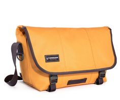 Timbuk2 Classic Messenger Bag -- Timbuk2 have updated their Classic Messenger Bag with aesthetic tweaks, better carry ergonomics, and improved interior bag organisation. The new shoulder strap is curved and has airmesh strap padding for better comfort. A new low profile grab handle offers a discrete carry option. And internal pockets have been placed to better balance the distribution of weight you carry. Available in a wide range colour designs.
