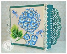 Designed by Laine. Sheena Douglass A Little Bit Fantasy A5 Stamp Set - Hydrangea Stamp. Sheena Douglass A Little Bit Scenic A5 Stamp Set - Flying Colours Stamp.  Spectrum Noir markers/pencils used: TB1, TB3, DG2, DG3, DG3, + 48, 56, 65, 68. Dragonflies are stamped with Spectrum Noir marker TB3. #spectrumnoir #sheena #crafterscompanion #flowers #crafting #dragonflies #diesire